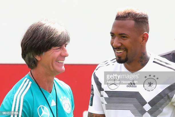 Jerome Boateng smiles with Joachim Loew head coach of Germany during a training session of the German national team at Sportanlage Rungg on day nine...