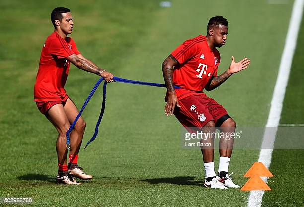 Jerome Boateng trains with Thiago during a training session at day three of the Bayern Muenchen training camp at Aspire Academy on January 8 2016 in...