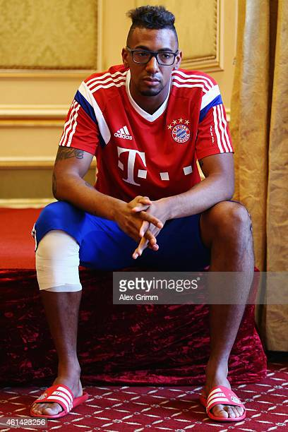 Jerome Boateng waits for a press conference during day 4 of the Bayern Muenchen training camp at ASPIRE Academy for Sports Excellence on January 12...