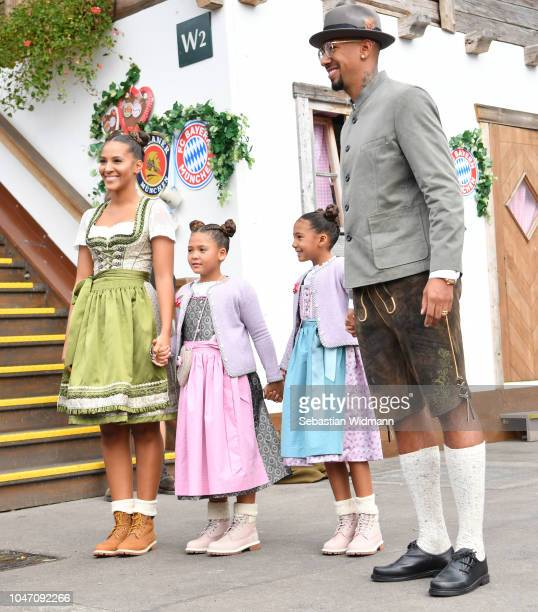 Jerome Boateng with Sherin Senler and his kids Lamia Boateng and Soley Boateng attend the Oktoberfest beer festival at Kaefer Wiesenschaenke tent at...