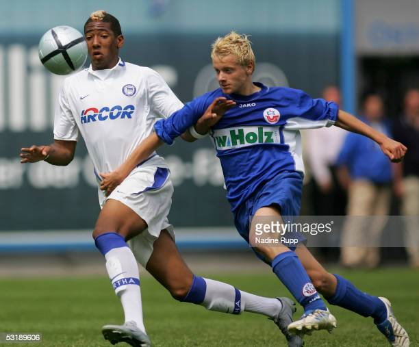 Jerome Boating of Hertha competes with Felix Drecoll of Rostock during the B Juniors Bundesliga Final between Hansa Rostock and Hertha BSC Berlin at...