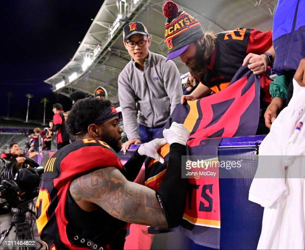 Jerome Couplin of the LA Wildcats signs an autograph for a fan after playing the Tampa Bay Vipers at Dignity Health Sports Park during an XFL game on...