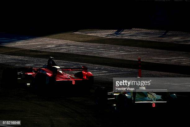 Jerome d'Ambrosio of Belgium and Dragon Racing with Lucas di Grassi of Brazil and ABT Schaeffler Audi Sport during the Mexico City Formula E...