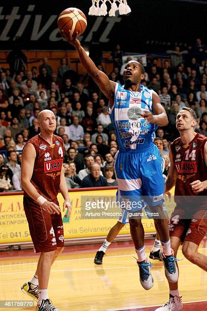 Jerome Dyson of Banco di Sardegna competes with Hrvoje Peric and Tomas Ress of Umana during the Lega Basket serie A1 match between Umana Reyer...