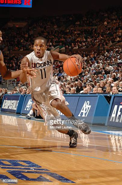 Jerome Dyson of the Connecticut Huskies dribbles the ball against the West Virginia Mountaineers during the quarterfinals of the Big East Conferance...