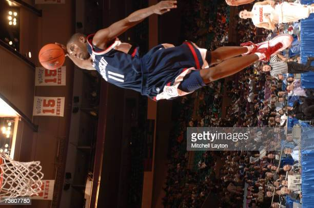 Jerome Dyson of the Connecticut Huskies goes for a dunk against the Syracuse Orange in the Big East Tournament First Round at Madison Square Garden...