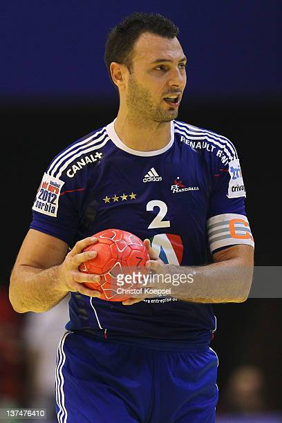 Jerome Fernandez of France passes the ball during the Men's European Handball Championship group C match between France and Hungary at Spens Arena on...