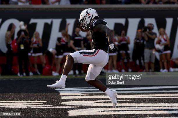 Jerome Ford of the Cincinnati Bearcats scores a touchdown in the third quarter against the Murray State Racers at Nippert Stadium on September 11,...