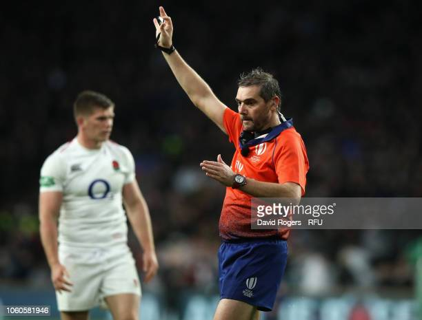 Jerome Garces the referee issues a penalty during the Quilter International match between England and New Zealand at Twickenham Stadium on November...