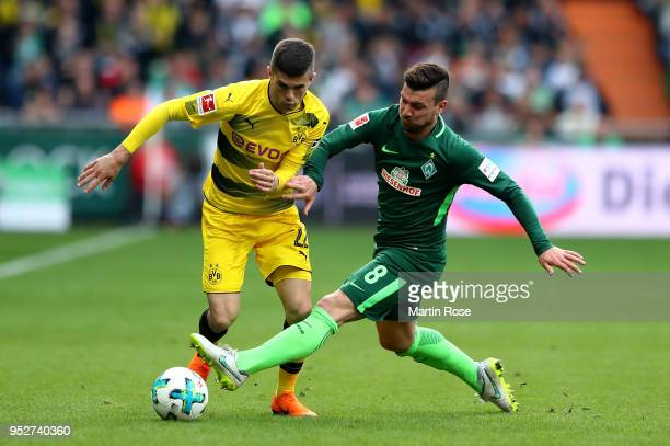 Jerome Gondorf of Bremen and Christian Pulisic of Dortmund battle for the ball during the Bundesliga match between SV Werder Bremen and Borussia...