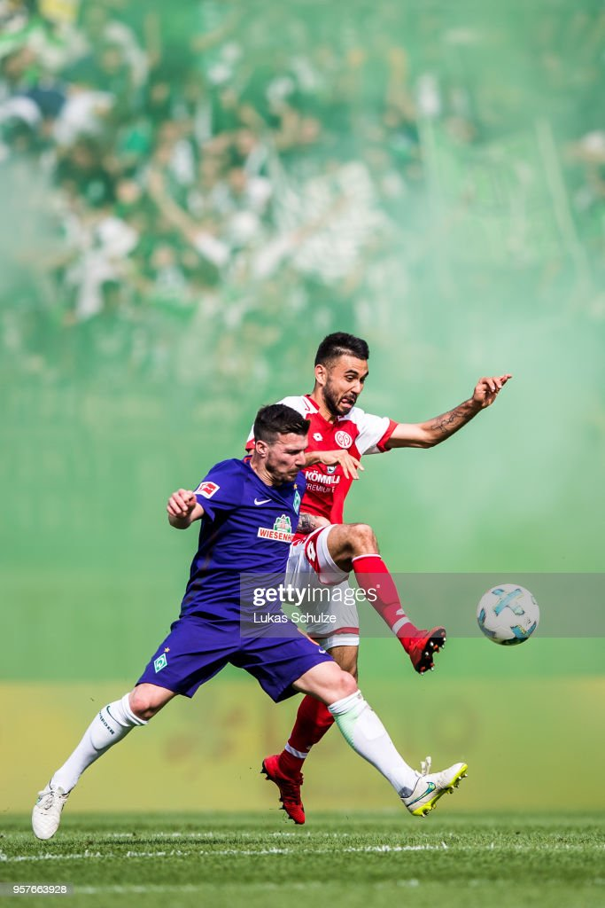 Jerome Gondorf (L) of Bremen and Gerrit Holtmann (R) of Mainz in action during the Bundesliga match between 1. FSV Mainz 05 and SV Werder Bremen at Opel Arena on May 12, 2018 in Mainz, Germany.