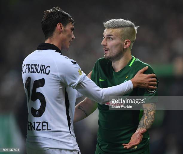 Jerome Gondorf of Bremen discusses a challenged by Pascal Stenzel of Freiburg during the DFB Cup match between Werder Bremen and SC Freiburg at...