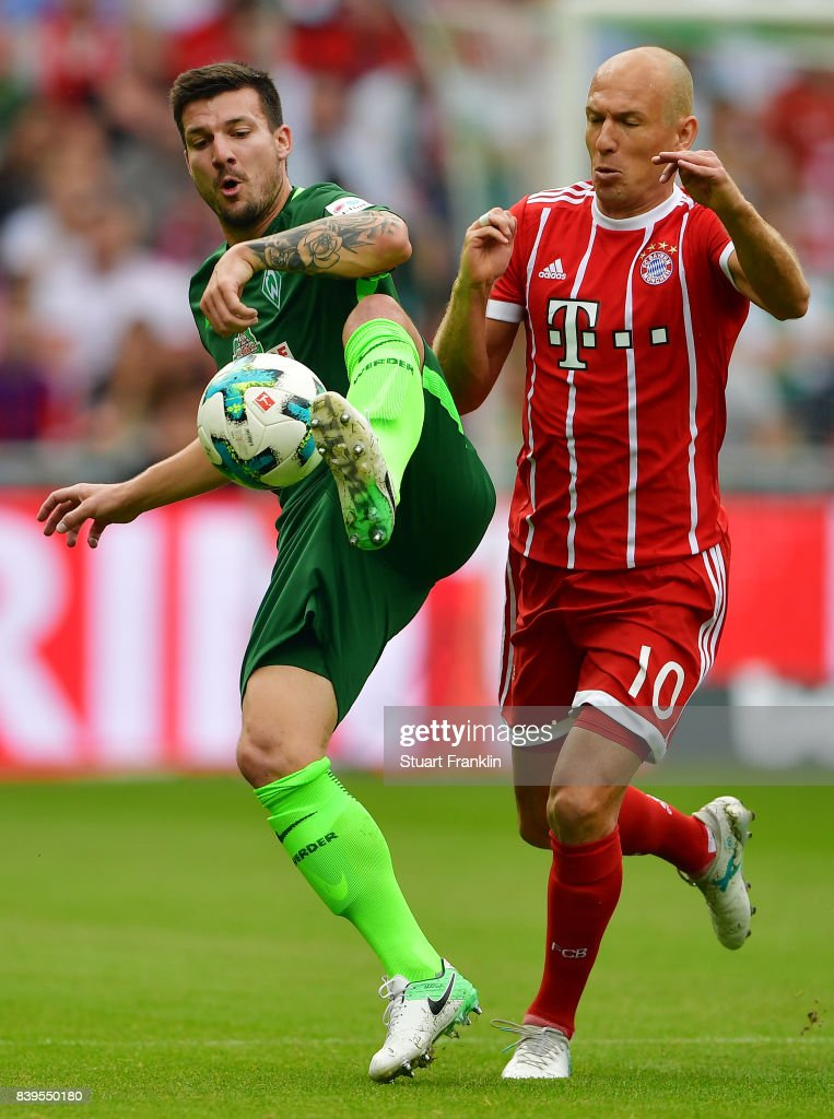 Jerome Gondorf of Bremen (l) fights for the ball with Arjen Robben of Bayern Muenchen during the Bundesliga match between SV Werder Bremen and FC Bayern Muenchen at Weserstadion on August 26, 2017 in Bremen, Germany.