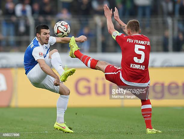 Jerome Gondorf of Darmstadt and Manuel Konrad of Frankfurt compete for the ball during the Second Bundesliga match between SV Darmstadt 98 and FSV...