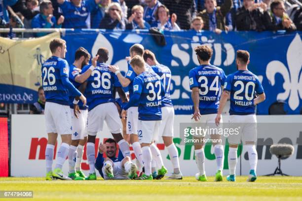Jerome Gondorf of Darmstadt celebrates his team's second goal with his team mates during the Bundesliga match between SV Darmstadt 98 and SC Freiburg...
