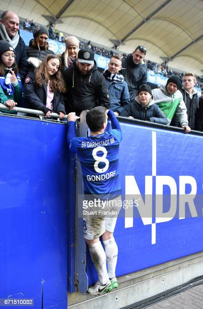 Jerome Gondorf of Darmstadt celebrates with fans after the Bundesliga match between Hamburger SV and SV Darmstadt 98 at Volksparkstadion on April 22...