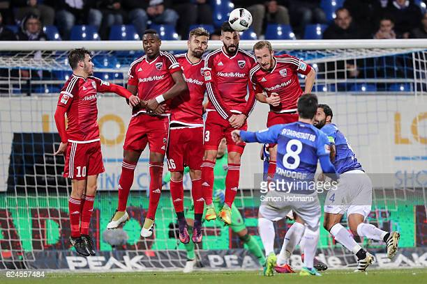 Jerome Gondorf of Darmstadt tries to score with a freekick against Pascal Gross Roger de Oliveira Bernardo Lukas Hinterseer Anthony Jung and Moritz...