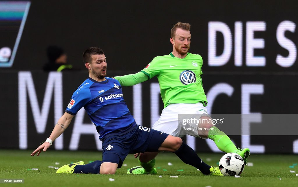 Jerome Gondorf (L) of Darmstadt vies with Maximilian Arnold (R) of Wolfsburg during the Bundesliga match between VfL Wolfsburg and SV Darmstadt 98 at Volkswagen Arena on March 18, 2017 in Wolfsburg, Germany.