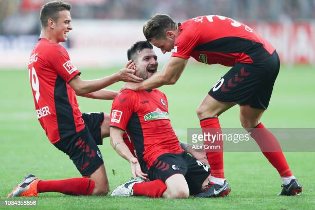 Jerome Gondorf of Freiburg celebrates his team's second goal with team mates Janik Haberer and Christian Guenter during the Bundesliga match between...