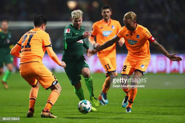 Jerome Gondorf of Werder Bremen battles for the ball with Benjamin Hubner and Kevin Vogt of TSG 1899 Hoffenheim during the Bundesliga match between...
