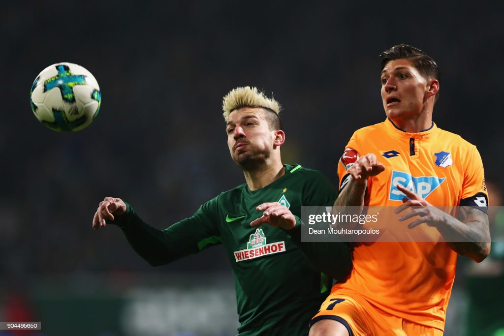 Jerome Gondorf of Werder Bremen battles for the ball with Steven Zuber of TSG 1899 Hoffenheim during the Bundesliga match between SV Werder Bremen and TSG 1899 Hoffenheim at Weserstadion on January 13, 2018 in Bremen, Germany.