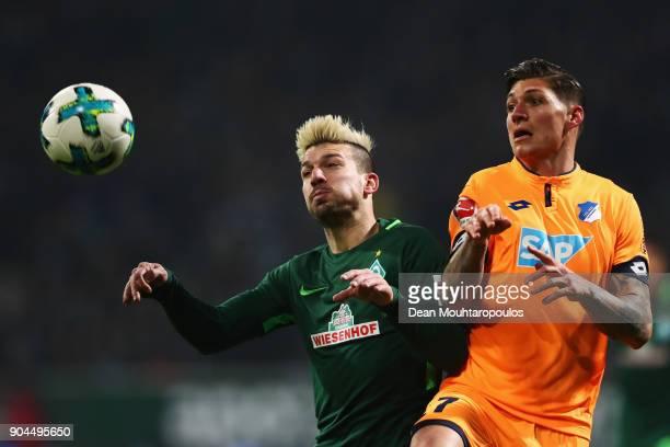Jerome Gondorf of Werder Bremen battles for the ball with Steven Zuber of TSG 1899 Hoffenheim during the Bundesliga match between SV Werder Bremen...