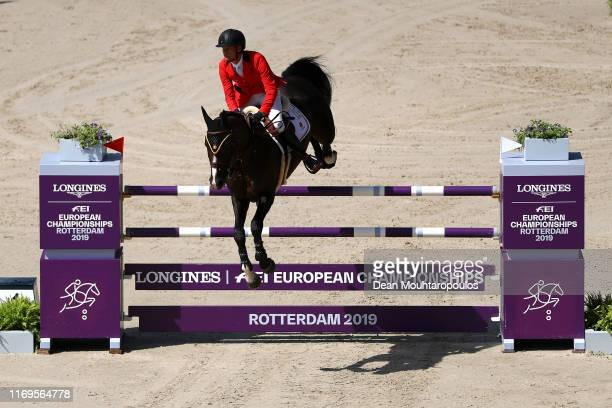 Jerome Guery of Belgium riding Quel Homme de Hus competes during Day 4 of the Longines FEI Jumping European Championship 2nd part, team Jumping 1st...