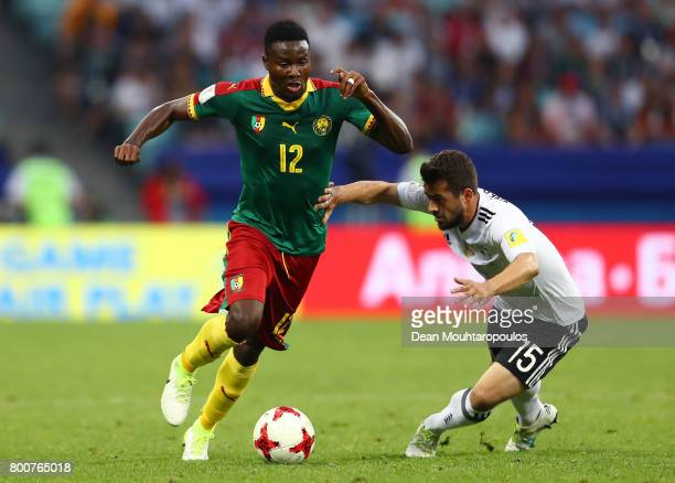 Jerome Guihoata of Cameroon takes the ball past Amin Younes of Germany during the FIFA Confederations Cup Russia 2017 Group B match between Germany...