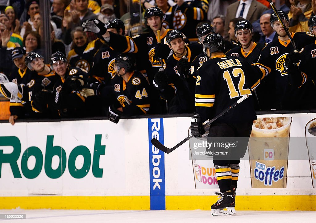 Jerome Iginla #12 of the Boston Bruins is congratulated by his teammates after scoring in an overtime shootout against the Anaheim Ducks at TD Garden on October 31, 2013 in Boston, Massachusetts.