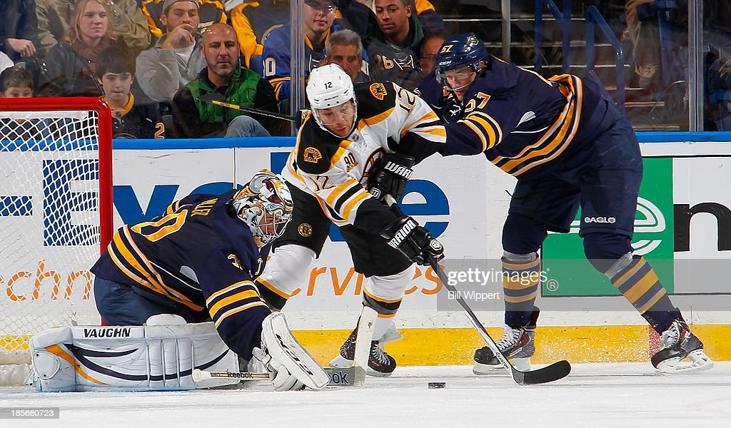 Jerome Iginla #12 of the Boston Bruins tries to score against Ryan Miller #30 of the Buffalo Sabres while defended by Tyler Myers #57 of the Sabres on October 23, 2013 at the First Niagara Center in Buffalo, New York. Boston defeated Buffalo, 5-2.