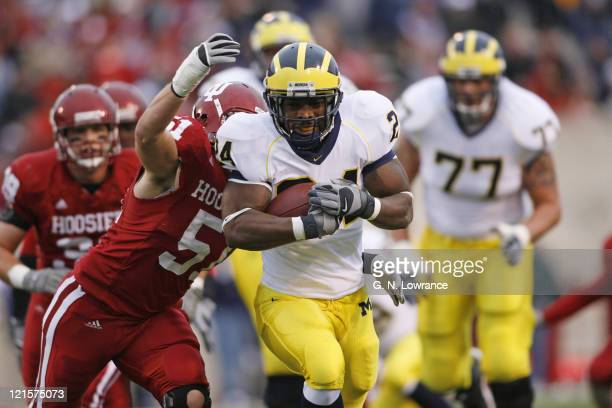 Jerome Jackson of Michigan runs for yardage during action between the Michigan Wolverines and Indiana Hoosiers at Memorial Stadium in Bloomington...
