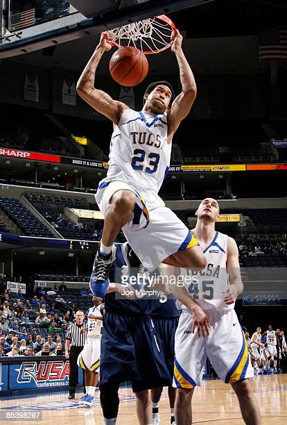 Jerome Jordan of the Tulsa Golden Hurricane dunks the ball past Lawrence Ghoram of the Rice Owls during the Quarterfinals of the Conference USA...