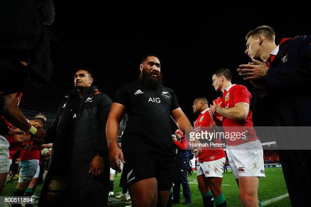 Jerome Kaino and Charlie Faumuina of the All Blacks walk off after winning the Test match between the New Zealand All Blacks and the British Irish...