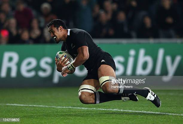Jerome Kaino of the All Blacks goes over to score a try during the IRB 2011 Rugby World Cup Pool A match between New Zealand and Tonga at Eden Park...