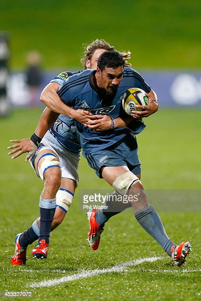Jerome Kaino of the All Blacks is tackled against Northland during the New Zealand All Blacks Game of Three Halves at North Harbour Stadium on August...