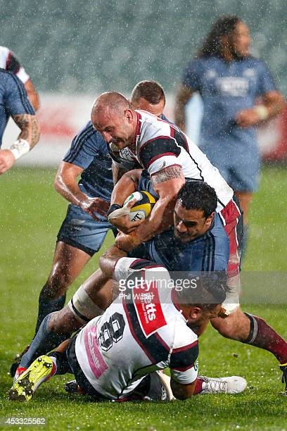 Jerome Kaino of the All Blacks is tackled by Hayden Triggs of North Harbour during the New Zealand All Blacks Game of Three Halves at North Harbour...