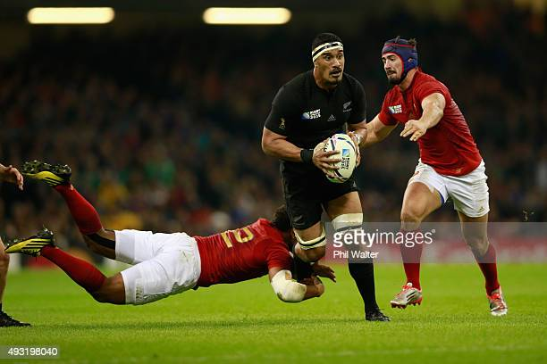 Jerome Kaino of the All Blacks is tackled during the 2015 Rugby World Cup Quarter Final match between New Zealand and France at Millennium Stadium on...