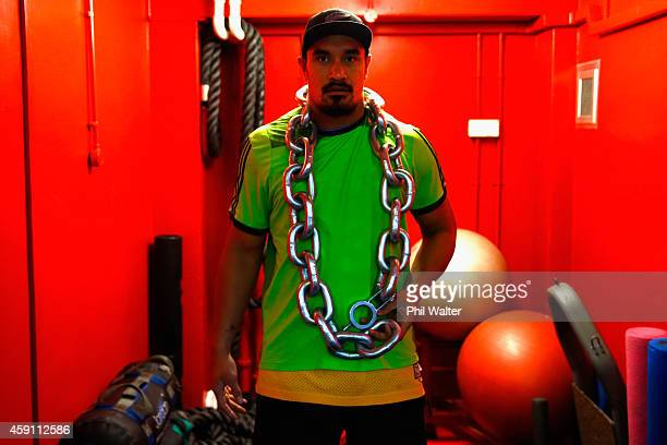 Jerome Kaino of the All Blacks wears a metal chain during a New Zealand All Blacks Gym session at the Cardiff University Strength and Conditioning...