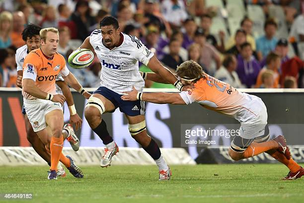Jerome Kaino of the Blues getting tagged by Boom Prinsloo of the Cheetahs during the Super Rugby match between Toyota Cheetahs and Blues at Free...