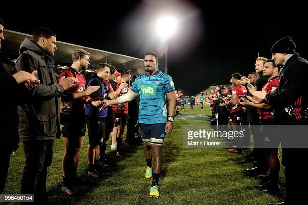 Jerome Kaino of the Blues is clapped from the field by the Crusaders players after the round 19 Super Rugby match between the Crusaders and the Blues...