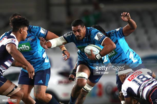 Jerome Kaino of the Blues is tackled during the round 16 Super Rugby match between the Blues and the Rebels at Eden Park on June 2 2018 in Auckland...