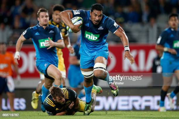 Jerome Kaino of the Blues is tackled during the round eight Super Rugby match between the Blues and the Hurricanes at Eden Park on April 15 2017 in...