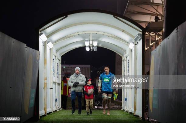 Jerome Kaino of the Blues leaves the field together with former All Black Corey Flynn after his last Super Rugby match during the round 19 Super...
