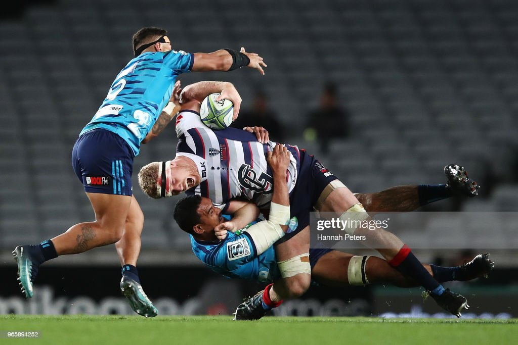 Jerome Kaino of the Blues tackles Matt Philipm of the Rebels during the round 16 Super Rugby match between the Blues and the Rebels at Eden Park on June 2, 2018 in Auckland, New Zealand.
