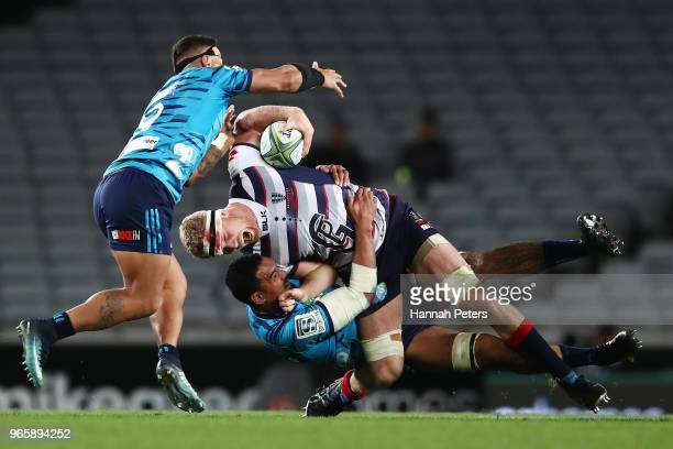 Jerome Kaino of the Blues tackles Matt Philipm of the Rebels during the round 16 Super Rugby match between the Blues and the Rebels at Eden Park on...