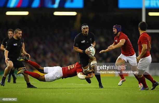 Jerome Kaino of the New Zealand All Blacks breaks through the tackle of Wesley Fofana of France during the 2015 Rugby World Cup Quarter Final match...