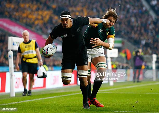 Jerome Kaino of the New Zealand All Blacks evades Lodewyk De Jager of South Africa en route to scoring the first try during the 2015 Rugby World Cup...