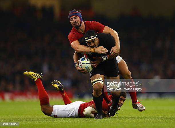 Jerome Kaino of the New Zealand All Blacks tries to break the tackle of Alexandre Dumoulin of France during the 2015 Rugby World Cup Quarter Final...