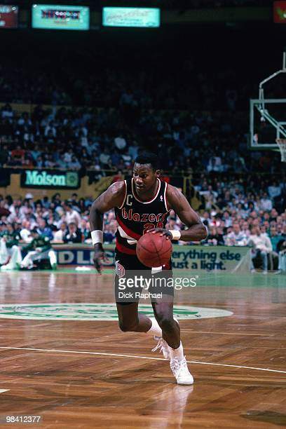 Jerome Kersey of the Portland Trail Blazers drives the ball up court against the Boston Celtics during a game played in 1989 at the Boston Garden in...