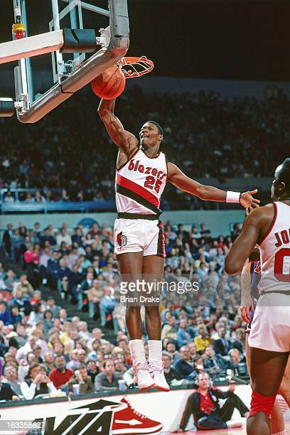 Jerome Kersey of the Portland Trail Blazers dunks during a game at the Veterans Memorial Coliseum in Portland Oregon circa 1986 NOTE TO USER User...